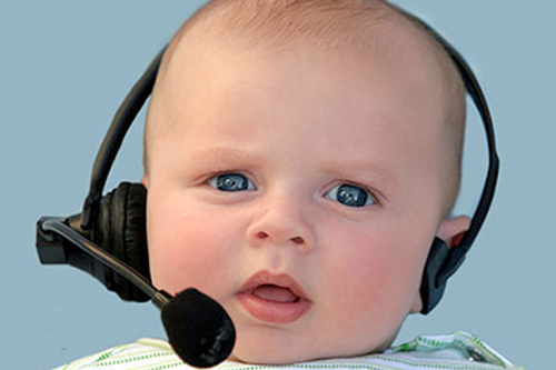 Image of a confused looking baby wearing a headset